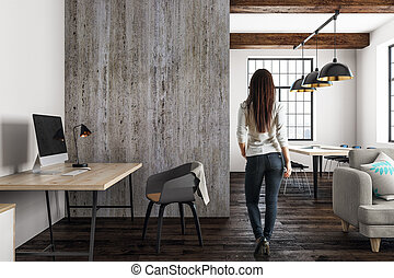 Woman in modern open space interior