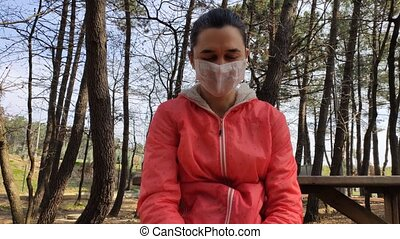 Woman in nature sneezing into elbow. Preventive measures in ...