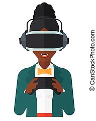 Woman in oculus rift and console in hands. - An...