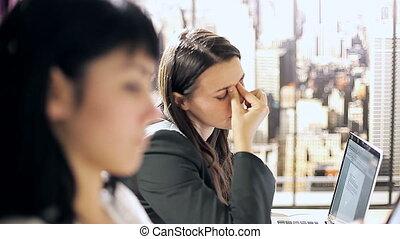 Woman in office headache