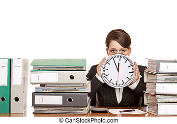 Woman in office is stressed because of time pressure. ...
