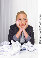 woman in office with crumpled paper