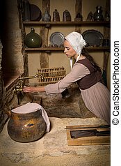 Woman in old kitchen