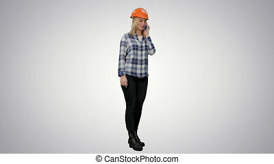 Woman in orange hardhat calling the phone on white background.