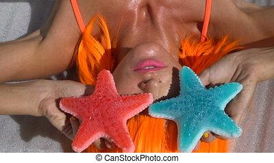 Woman in orange wig - Closeup face of happy beautiful woman...