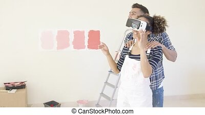 Woman in overalls and virtual reality glasses gets help from...