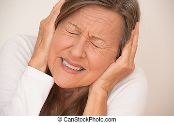 Woman in pain with headache migraine