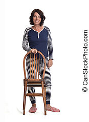 woman in pajamas playing on a chair on white backgraund,