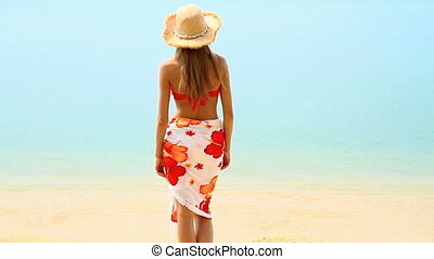 Woman in pareo and bikini at tropic