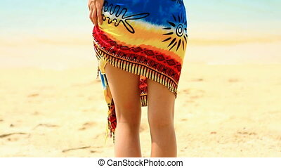Woman in pareo and bikini at tropic - Woman wearing pareo...