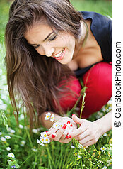 woman in park gather spring flowers