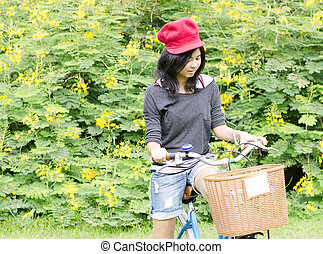 Woman in park with bike