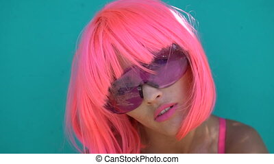 Woman in pink bra and wig - Closeup portrait of sexy...