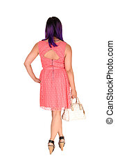 Woman in pink dress.