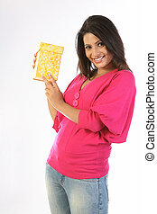 Woman in pink dress holding giftbox