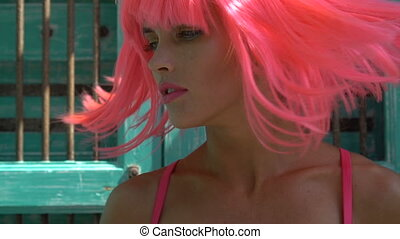 Woman in pink lingerie and wig - Closeup portrait of sexy...
