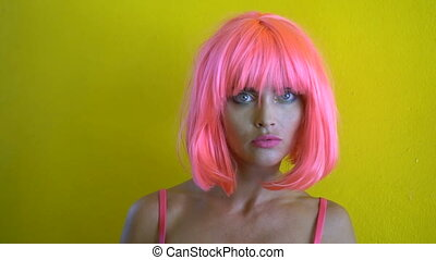Woman in pink lingerie and wig
