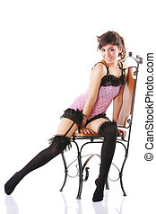 Woman in pink on chair setting leg aside