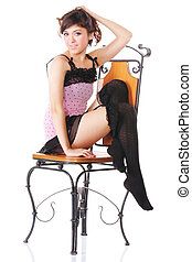 Woman in pink sitting on chair sideview