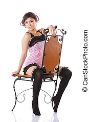 Woman in pink straddling a chair