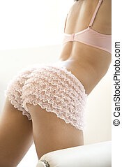 Woman in pink underwear. - Back side of young adult woman...