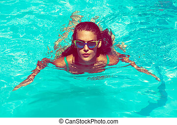woman in pool - young attractive woman swimm in pool with ...