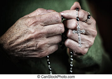 woman in pray - hands with classic catholic rosary