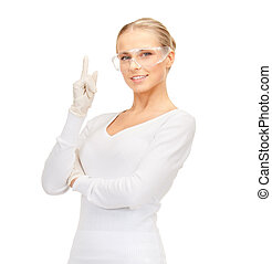 woman in protective glasses and gloves - healthcare and...