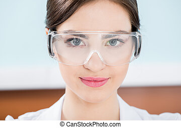 Woman in protective glasses - Attractive young woman in...