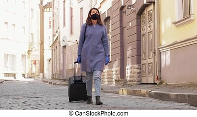 woman in protective mask with travel bag in city - health, ...