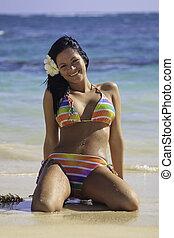 woman in rainbow bikini at a hawaii beach