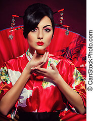 woman in red Asian costume