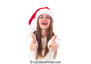 Woman in red christmas hat showing thumbs up