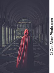 Woman in red cloak walking away