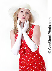 woman in red dress and white gloves touching face