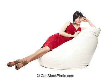 Woman in red dress laying on armchair
