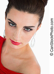 Woman in red dress looking at camera