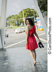 Woman in red dress looking back