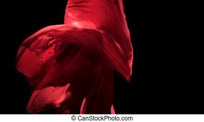 Woman in red dress performs elegant movements with her hands...
