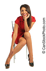 Woman in red dress sitting on a chair.