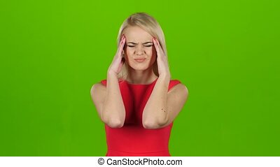 Woman in red dress suffers from headache and does massage