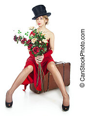 Woman in red dress with a bouquet of flowers