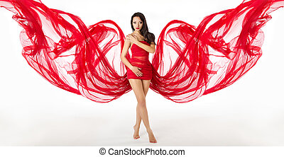 Woman in red flying waving dress as wings on a wind flow. Over white background