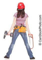 Woman in red helmet holding saw and drill