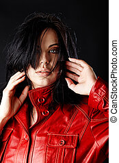 woman in red leather jacket.