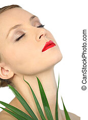 Woman in red lipstick at a spa