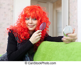 Woman in red periwig