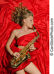 Woman in red playing the saxophone