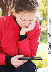 Woman in red reading electronic book