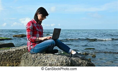 Woman in red shirt with notebook